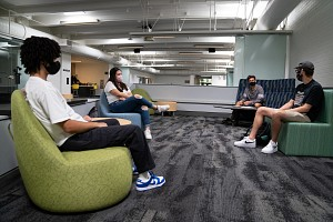 students sitting indoors, socially distant
