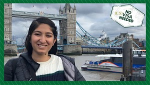student in front of London bridge